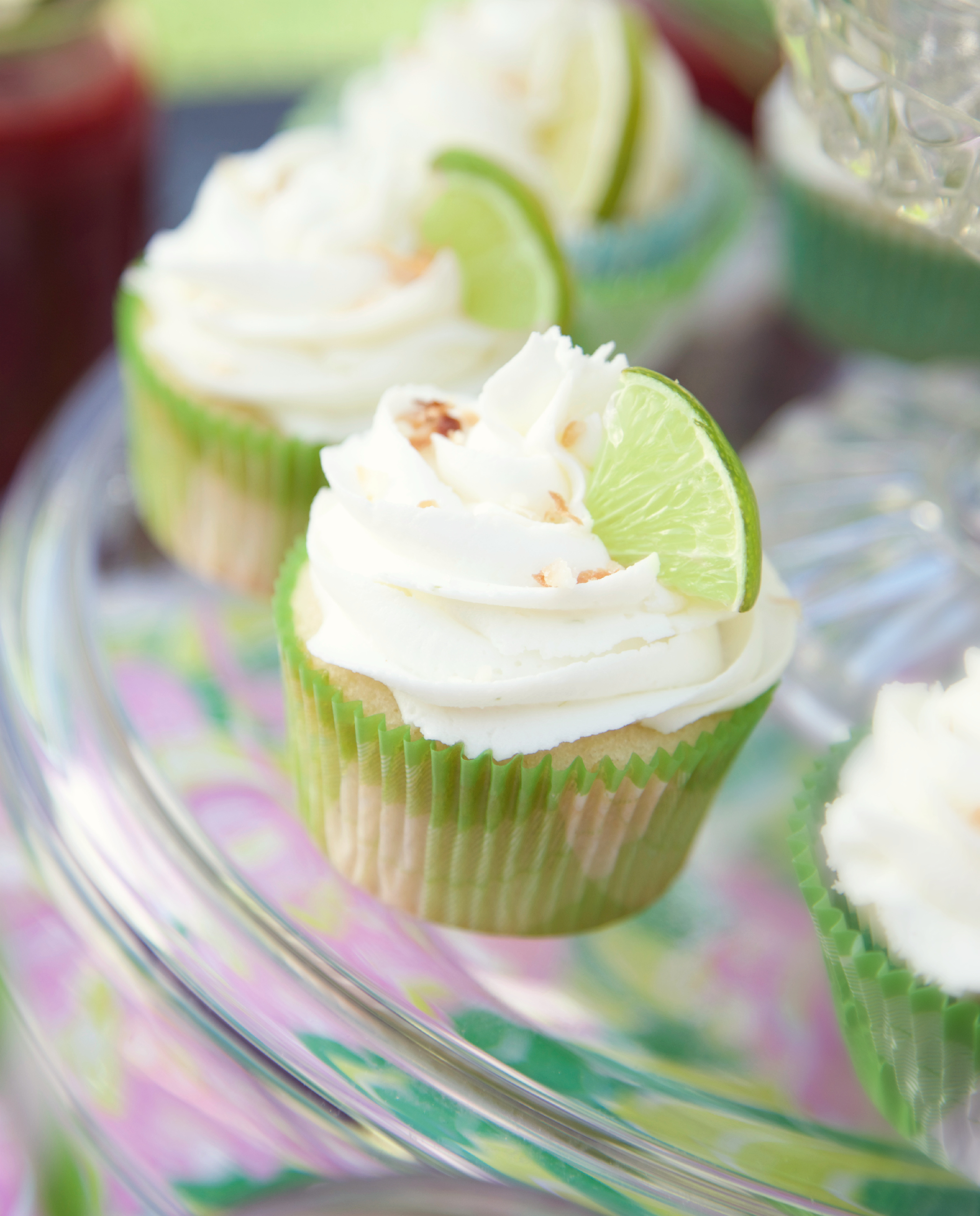 Coconut cupcakes, raspberry filling and lime buttercream. Recipe included!