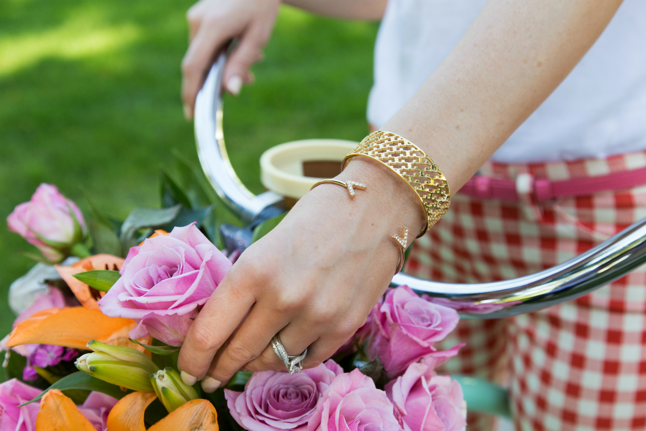 Gold stack bracelets from Tory Burch and Sparkle and Whim