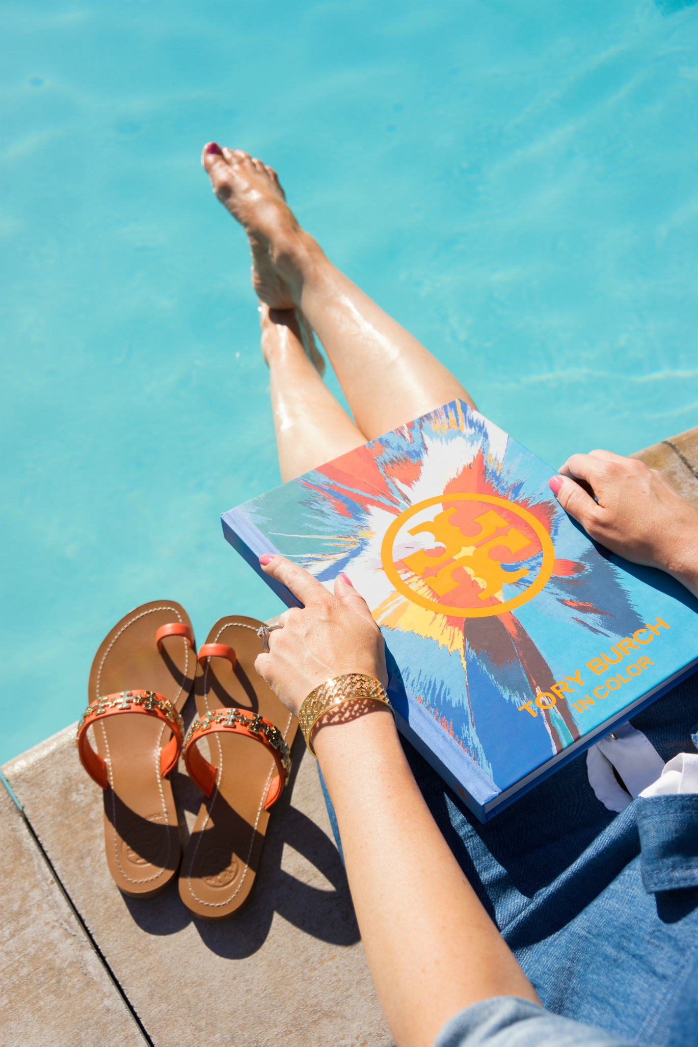 The Sugared Lemon Tory Burch In Color poolside and orange toe ring logo sandals and bracelet