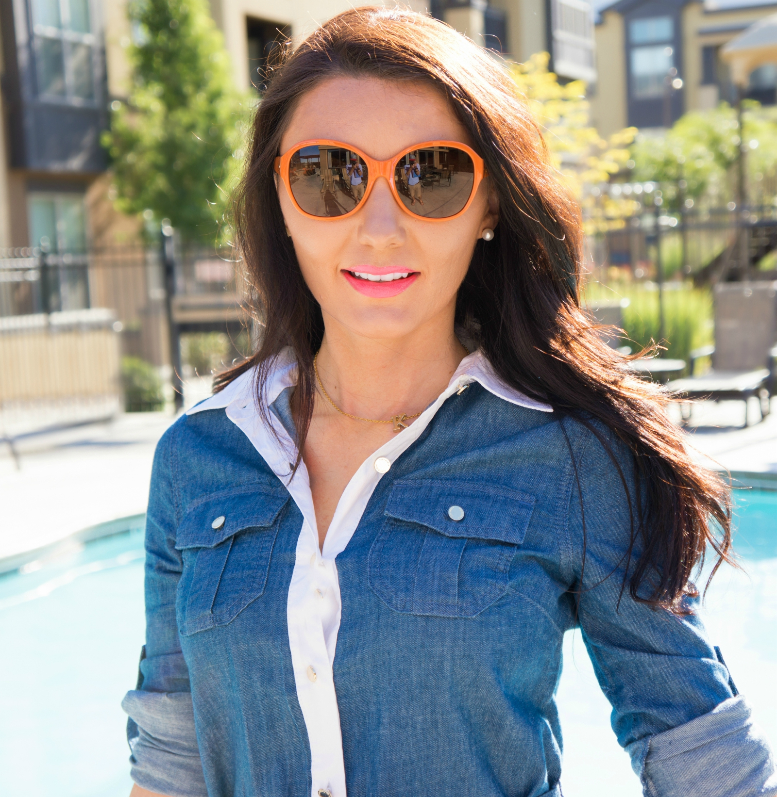 The Sugared Lemon Tory Burch Orange logo sunglasses. So cute for summer!!