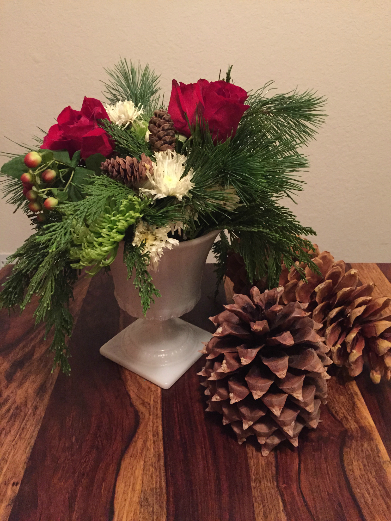 christmas flowers with fresh winter pinecones